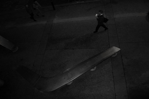 street urban man london businessman night londonbridge dark bench walking wind pavement negativespace shape boomerang tarmak whitepaper lx3 urbanlyric povfromabove