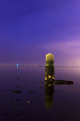 Sea tower - Day #118 (Stolen Art) Tags: ocean blue ireland sea sky howth dublin irish tower water oneaday yellow night purple year pillar 365 challenge clontarf 365challenge baylongexposure