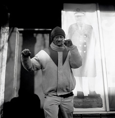 (m. wriston) Tags: city winter portrait people urban usa sunlight white man black cold 6x6 tlr film face contrast america square point shadows united grain broadway maryland baltimore 200iso mat human fells 124g fist boxer medium format ronnie states punch pushed edu ultra yashica fists 100iso arista