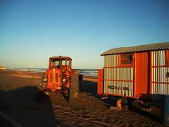 sand wind and fire (Javier Volcan) Tags: blue sky orange tractor argentina sunshine atardecer sand nikon peach playa arena naranja d60 jdvolcan jdvolcangmailcom