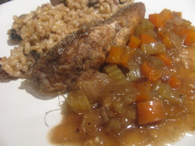 Buckwheat coated chicken breast with mushrooms in pearl barley and culinary trinity.