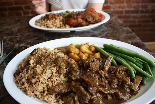 Goat curry with rice and two sides, $8.99.