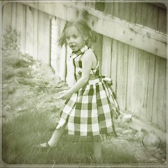At play (provincijalka) Tags: portrait blur texture girl childhood fence square shoe backyard poem child thankyou dress legs time walk nowhere running monochromatic haunted nostalgia step memory messyhair imagination surprised pigtails amused now somewhere checkered atwork maryjane atplay timeless remembering emilydickinson likethen provincijalka bylesbrumes