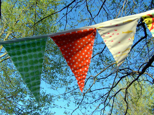 Bunting on blue sky, lots of dots