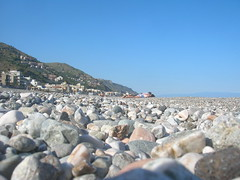On the (cobbly) beach of Letojanni (etnaboris) Tags: family sea summer italy sun primavera beach beautiful sunshine relax spring holidays italia mare estate famiglia shore sicily sole spiaggia sicilia vacanze ionio