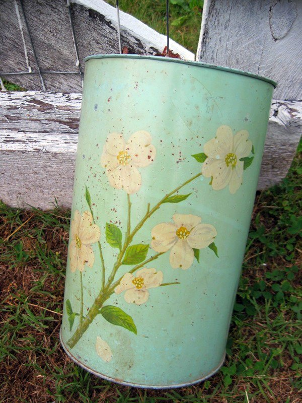 Vintage metal trashcan with dogwood flowers