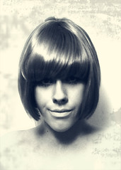 Looking at My Timeline (Claire Basiuk) Tags: new old hair 60s edited photoshopped eerie wig weathered wigs smirk bangs passport damaged sixties greyscale passportphotograph seldportrait