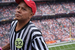 beer vendor at invesco field (bradleygee) Tags: red white man black blur game beer football colorado stadium stripes sony nfl denver browns vendor dslr broncos selling 32 invescofield a300