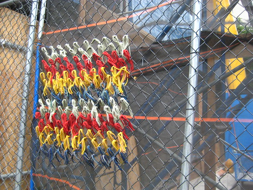 inexplicable weaving on construction fence
