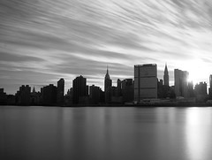 (Vitaliy P.) Tags: city bw sun white motion black building glass clouds island moving still nikon long exposure day state time manhattan welding side smooth silhoettes east un empire flare lic gothamist chrystler d80 18135mm shade11 vitaliyp gettysubmitted