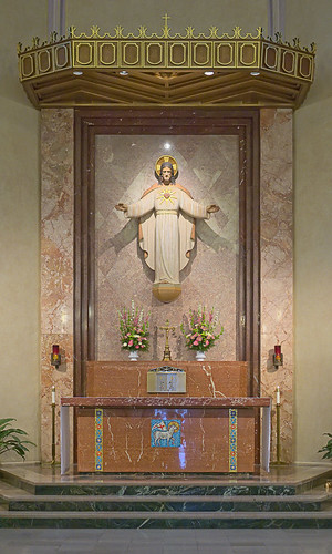Sacred Heart Roman Catholic Church, in Florissant, Missouri, USA - high altar with Sacred Heart statue and tabernacle