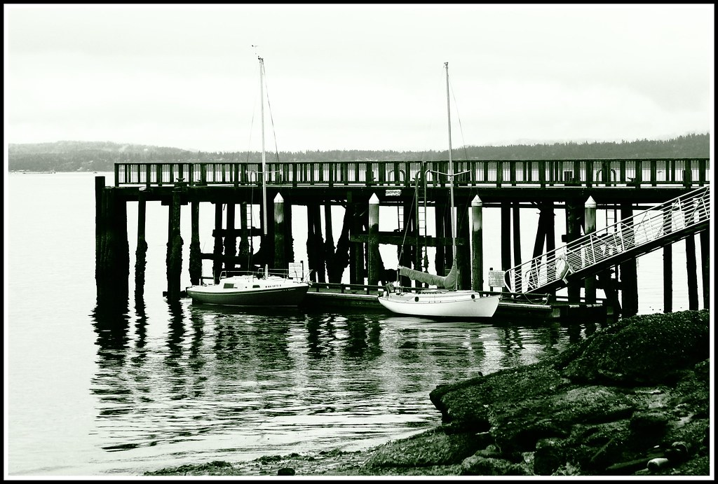 Boats on the bay in Port Townsend, WA. Black and white.