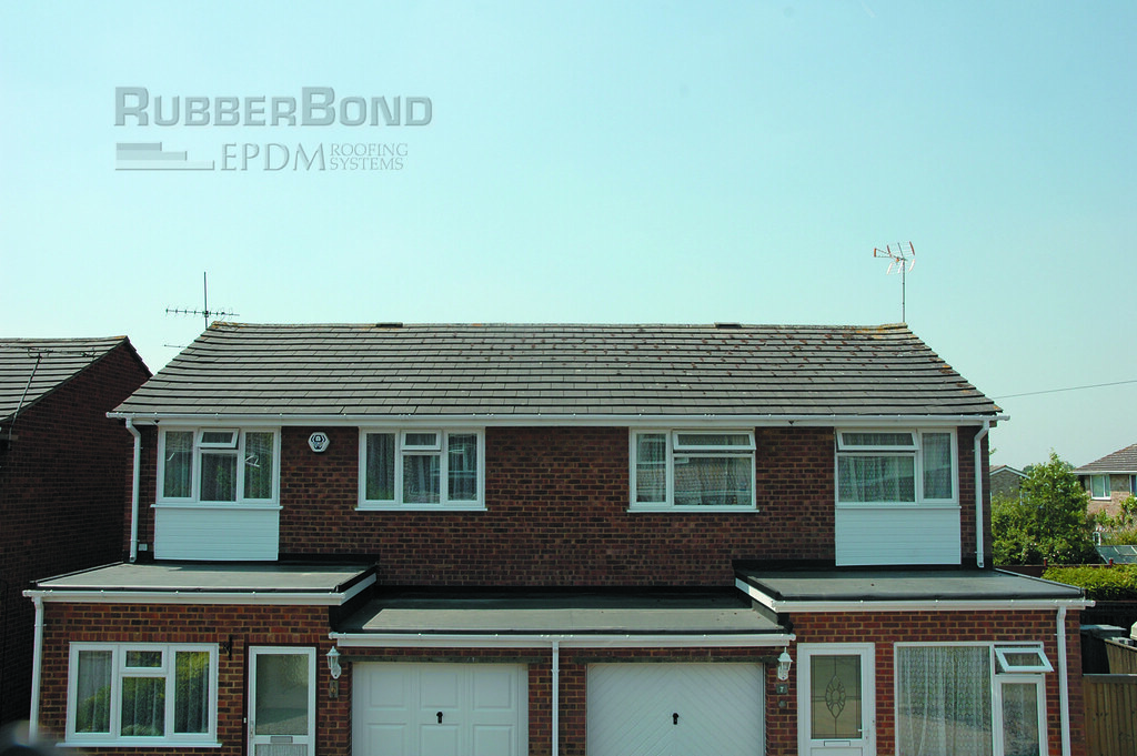 Semi detached houses with matching RubberBond flat roofs