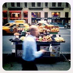 fruit stand (Grey van der Meer) Tags: cameraphone nyc newyorkcity square polaroid taxi bald pedestrian midtown motionblur squareformat carnegiehall fruitstand 7thavenue iphone yellowcabs iphoneography irisphotosuite instagram