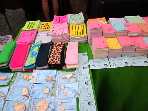 Raoul's blank books, pencil pouches, my notepads and wood jewelry at Craftstravaganzaa.