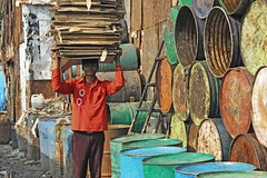 Cardboard & Drums (Meanest Indian) Tags: people india drums cardboard bombay recycle mumbai maharastra dharavi