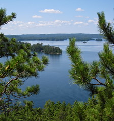 the view (ailie*) Tags: above blue trees lake green water pine clouds reflections islands high view horizon sunny calm ripples needles distance ailie highrock temagami