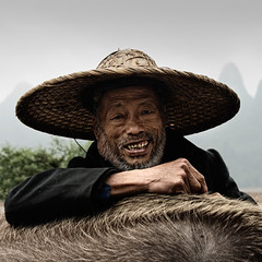 Yangshuo Farmer & Water Buffalo # 2 (An diabhal glas) Tags: china water river landscape li buffalo republic peoples farmer prc  peaks karst region province zhuang guangxi  autonomous yngshu  zhnggu guln  1on1photooftheweek xin 1on1photooftheweekjanuary2010