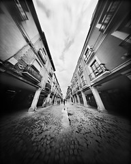Shopping in Alcala de Henares (4x5 Pinhole Photograph) (integrity_of_light) Tags: bw film spain pinhole cobblestones shops 4x5 stores oldtown zeroimage alcaladehenares zero45