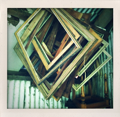 frames hanging in a shed