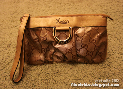 gucci wristlet gold GG lame fabric D-ring front