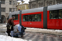 -Waiting for a better times- (Vt Hassan) Tags: street winter red snow man square photography sad prague image no candid side small homeless documentary any hardcore porsche reality czechrepublic material capture juxtaposition tramway lesser possession global tramwaj waitingforabettertimes
