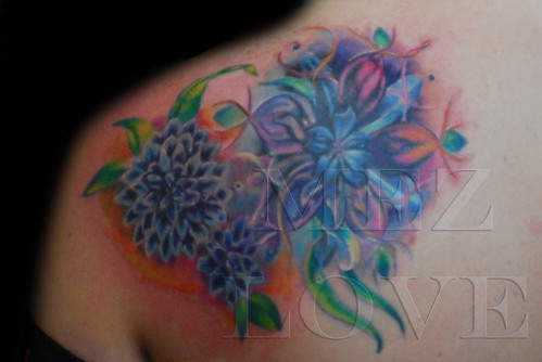 FEMALE SHOULDER FLOWER TATTOO Image taken upon