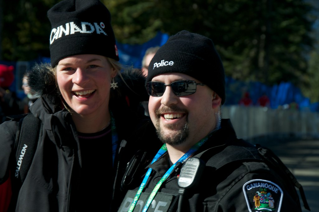Emily Brydon Poses with Police Officer