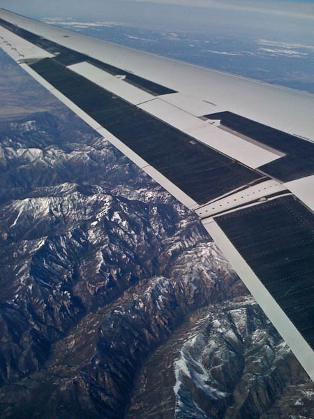 Flying over Snow Crested Mountains