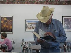 prosecution of george w. bush for murder (rhythmzslave) Tags: madera cowboy war reader iraq bookstore pensive denim cowboyhat iraqwar americansoldiers sanjoaquinvalley vincentbugliosi maderacalifornia booksandbagels prosecutionofgeorgewbushformurder