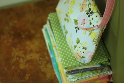 bag on stack of fabrics
