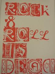 rock & roll is dead (somethingwonderfuldesign) Tags: red rock print words lyrics letters font type printmaking linocut roll linoprint elastica somethingwonderfuldesign