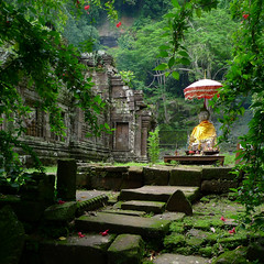 Shrine of Vat Phou overgrown by jungle (Bn) Tags: topf50 sacredplace topf100 topf200 watphou templemountain naturalspring champassak southernlaos champasak watphu redhibiscus 100faves 50faves 200faves vatphou anawesomeshot alongthemekongriver theunforgettablepictures mysteriousatmosphere laopeople fishermeninthemekong champasaksbestchoice khmersitesofwatphu westbankofthemekongriver kingdomofchampasak siteofvatphou exceptionalarcheologicalsite vatphoustartedaround1000ad nothernpalace ancientkhmerstemple henripamentier rediscoveredvatphouin1914 earlyangkorwatstyle unescoworldheritagesiteofvatphou phoukaomountain influencescomefromkhmerhinduandbuddhisttraditions protectedstatusin2001 reconstructionandrenovations shrineofvatphouovergrownbyjungle mossgrownbricks