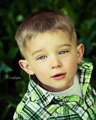 C. (Rebecca812) Tags: light boy portrait green beautiful children outside eyes backyard child c naturallight son canon5dmarkii lilyofvalleyleaves familygetty2010