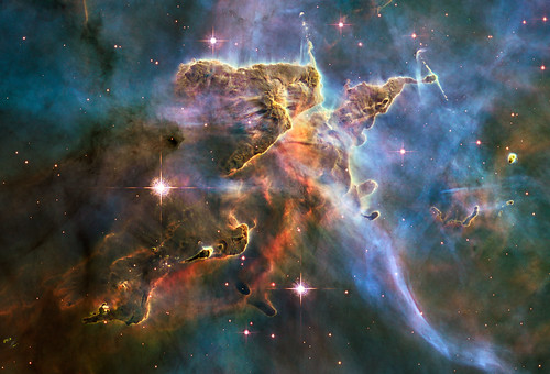 "Hubble Captures Spectacular ""Landscape"" in the Carina Nebula NASA image release April 22, 2010  NASAs Hubble Space Telescope captured this billowing cloud of cold interstellar gas and dust rising from a tempestuous stellar nursery located in the Carina Nebula, 7,500 light-years away in the southern constellation Carina. This pillar of dust and gas serves as an incubator for new stars and is teeming with new star-forming activity. Hot, young stars erode and sculpt the clouds into this fantasy landscape by sending out thick stellar winds and scorching ultraviolet radiation. The low-density regions of the nebula are shredded while the denser parts resist erosion and remain as thick pillars. In the dark, cold interiors of these columns new stars continue to form. In the process of star formation, a disk around the proto-star slowly accretes onto the stars surface. Part of the material is ejected along jets perpendicular to the accretion disk. The jets have speeds of several hundreds of miles per second. As these jets plow into the surround nebula, they create small, glowing patches of nebulosity, called Herbig-Haro (HH) objects.  Long streamers of gas can be seen shooting in opposite directions off the pedestal on the upper right-hand side of the image. Another pair of jets is visible in a peak near the top-center of the image. These jets (known as HH 901 and HH 902, respectively) are common signatures of the births of new stars. This image celebrates the 20th anniversary of Hubbles launch and deployment into an orbit around Earth. Hubbles Wide Field Camera 3 observed the pillar on Feb. 1-2, 2010. The colors in this composite image correspond to the glow of oxygen (blue), hydrogen and nitrogen (green), and sulfur (red). Object Names: HH 901, HH 902 Image Type: Astronomical  Credit: NASA, ESA, and M. Livio and the Hubble 20th Anniversary Team (STScI)  To read learn more about this image go to:  <a href=""http://www.nasa.gov/mission_pages/hubble/science/hubble20th-img.html"" rel=""nofollow"">www.nasa.gov/mission_pages/hubble/science/hubble20th-img....</a>  <b><a href=""http://www.nasa.gov/centers/goddard/home/index.html"" rel=""nofollow"">NASA Goddard Space Flight Center</a></b>  is home to the nations largest organization of combined scientists, engineers and technologists that build spacecraft, instruments and new technology to study the Earth, the sun, our solar system, and the universe."