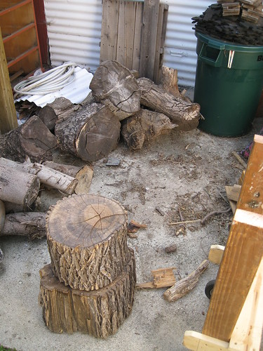 messy area in front of the garage and log racks