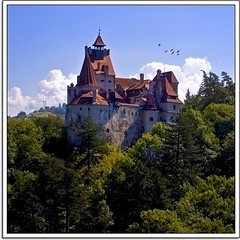Welcome to Transylvania (Nathan Bergeron Photography) Tags: light birds architecture clouds geotagged europe gothic bluesky dracula spire romania legends transylvania turret vampires easterneurope greenhills bran greentrees brancastle vladtheimpaler dragula carpathianmountains branstoker yearinfrance geo:lat=45515008 vladbasarab geo:lon=25346832