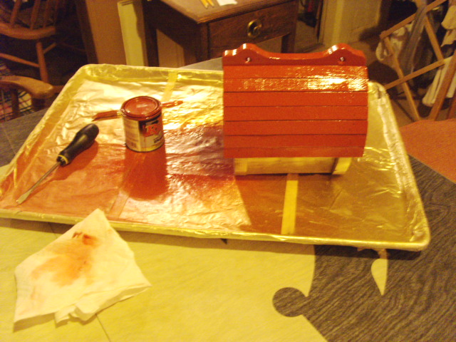 Applying second coat of paint