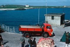 M. V. Columba loading operations, Tiree (1979) (The Douglas Campbell Show) Tags: uk house building landscape person coast scotland argyll vehicle isleoftiree