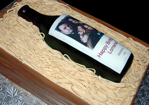 Wine bottle in a wooden crate birthday cake