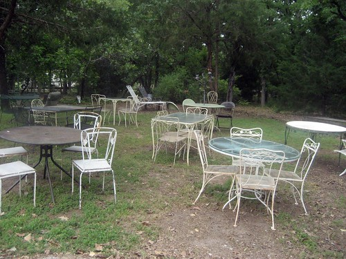 tables and chairs in yard