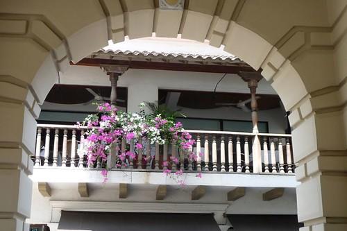 Pretty balcony through arch