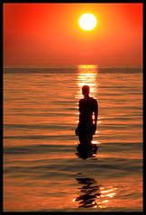 Another place, Crosby Beach, 23/05/10 (Ianmoran1970) Tags: sunset red orange sun beach water silhouette statue landscape waves wave ironman jar gormley anthonygormley anotherplace ianmoran blundelsands ianmoran1970