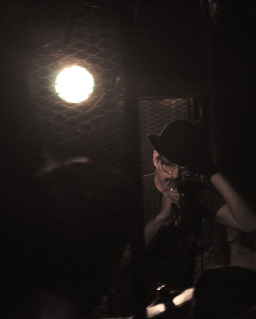 Yoni Wolf, wearing a crowd member's hat