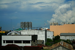Balikpapan... 1 hour away from home.. so close (sigh (gingycake) Tags: city clouds canon buildings bluesky canoneos350d balikpapan