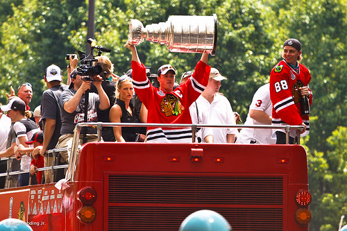 Jonathan Toews holding up the Stanley Cup