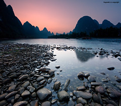The Eye Shadows of Karst Mountains (Ragstatic) Tags: world life china travel pink light sunset people mountains color reflection heritage nature silhouette river relax flow liriver li still nikon rocks exposure view image earth stones guilin rags quality culture scene ng karst publication nationalgeographic subtle guangxi xingping d700