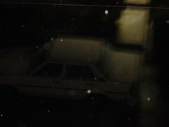 One of the Winter nights. (Somersaulting Giraffe) Tags: outdoor car building ngc buildings snow winter cool cold sony light dark night vehicle snowfall blur unfocus