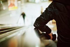 Yashica 01▸18 (ukaaa) Tags: black reflection film station leather analog train 35mm girlfriend dof belgium kodak bokeh escalator central belgië rangefinder depthoffield negative jacket elbow antwerp analogue 135 nobby portra yashica antwerpen centraal gx portra160vc electro35