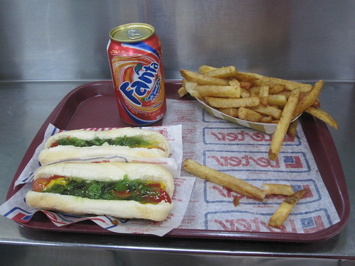 2 hot-dogs, frieds, Fanta - $7 including tip